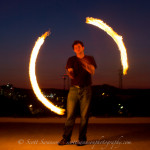 Fire spinning at sunset